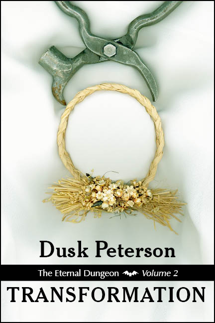 An iron instrument pinches a dried wreath of flowers